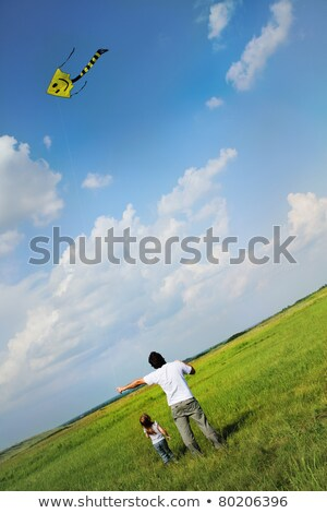 Stock fotó: Little Girl And Her Father With Flying A Kite