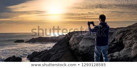 Pôr do sol costa água natureza luz mar Foto stock © kawing921