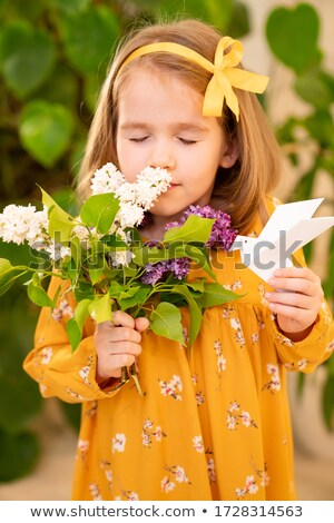 Portrait of Young Beauty with Colorful Origami Flowers. Bright Eye Make-Up stock photo © gromovataya