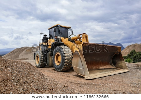 Yellow excavator on a hill  Stock photo © kawing921