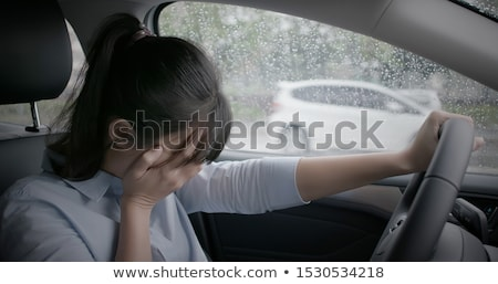 Crying woman in a car Stock photo © Nobilior