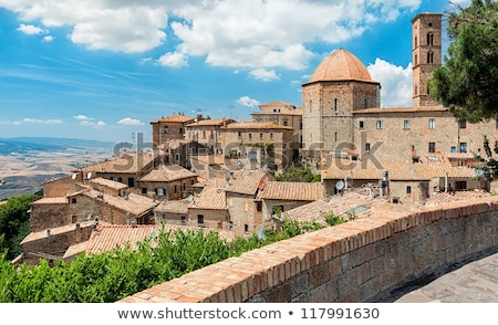 view of the roofs and landscape of a small town volterra in tusc stock photo © anshar