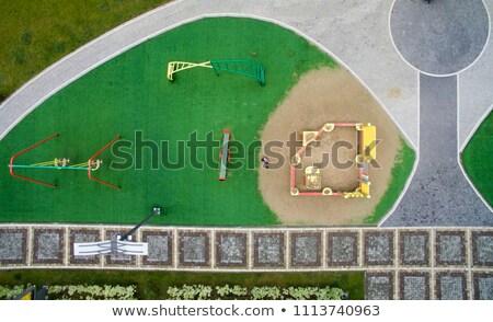 children park swing green grass high view Stock photo © lunamarina