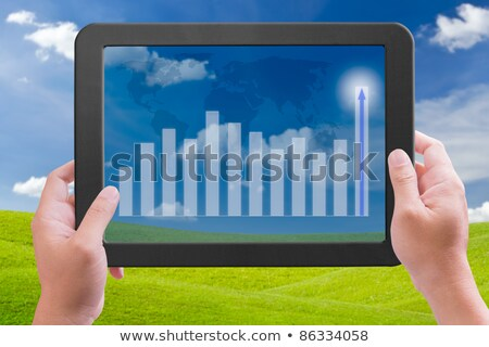 hand holding touch pad pc with higher graph Stock photo © tungphoto