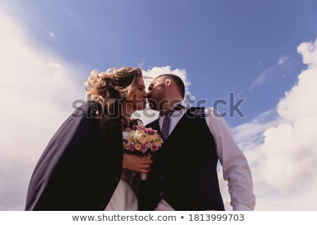 Bride in Wedding White Dress standing on a Cloud and Looking to the Ground Stock photo © gromovataya