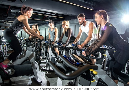 spinning in the gym stock photo © kzenon