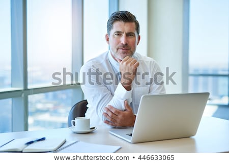 Thoughtful boss sitting at his desk Stock photo © stryjek