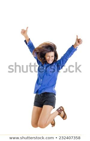 Genç kız atlama eller mutlu atlamak Stok fotoğraf © ambro