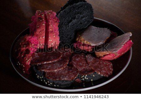 Gourmet snacks. Thin slices of beef with rye bread and fresh tom Stock photo © raphotos