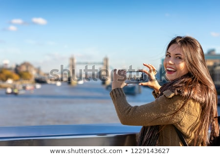Woman taking pictures with her smartphone stock photo © cwzahner