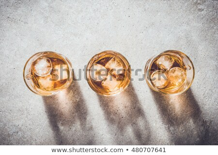 Uísque cinza vidro festa gelo coquetel Foto stock © Givaga
