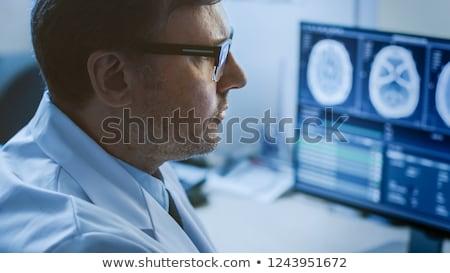 Médico mirando cerebro mri primer plano retrato Foto stock © HASLOO
