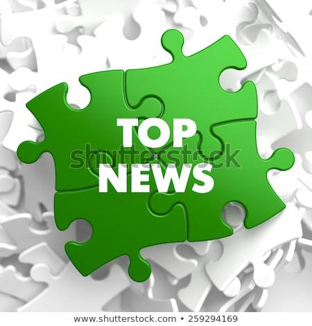 Codziennie wiadomości zielone puzzle biały działalności Zdjęcia stock © tashatuvango