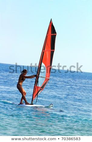 Surfer meisje Blauw zee oppervlak vrouw Stockfoto © Mikko