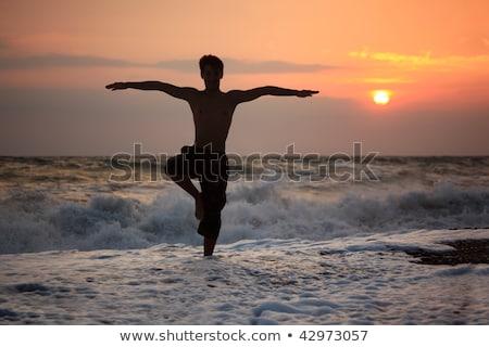 homem · ioga · costa · meditação · céu · água - foto stock © paha_l