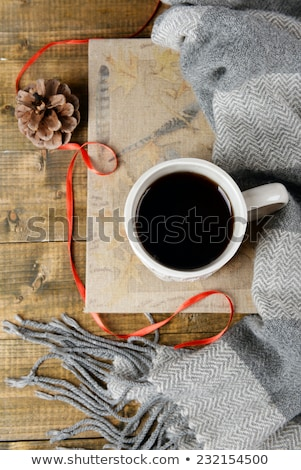 Close up of tea cup with christmas decoration on wooden table Stock photo © vlad_star
