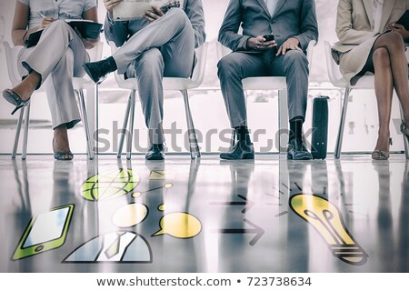 Composite image of low section of business people sitting on des Stock photo © wavebreak_media