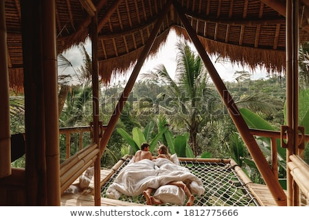 Loving couple in hammock kissing each other Stock photo © dash