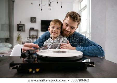 Boldog szakállas apa hallgat lemezek kicsi Stock fotó © deandrobot