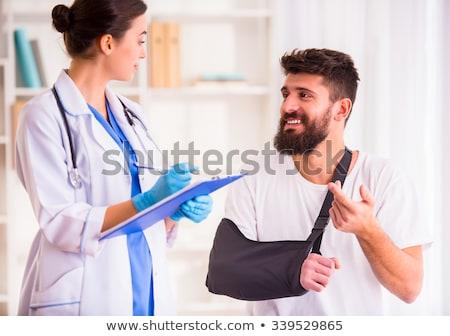 Herido médico roto brazo caucásico Foto stock © RAStudio