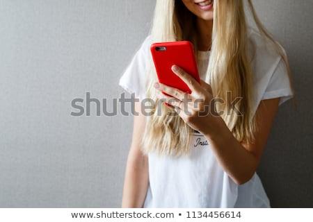若い女性 · スマートフォン · 白 · スタジオ · 女性 · 手 - ストックフォト © deandrobot