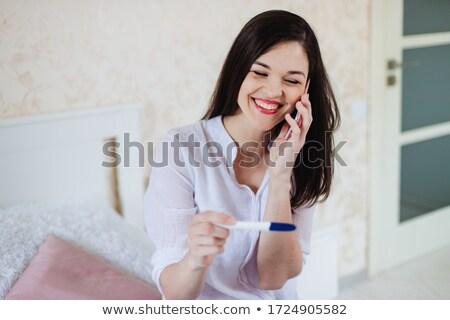счастливым · женщину · глядя · результат - Сток-фото © yatsenko