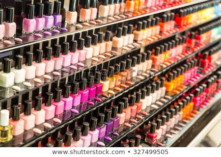 Set of different nail varnishes on shelves in cosmetic store Stock photo © vlad_star