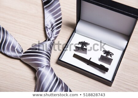 Man with box of cuff links Stock photo © Elnur
