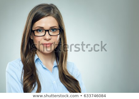 portrait of smiling young businesswoman in suit stock photo © deandrobot