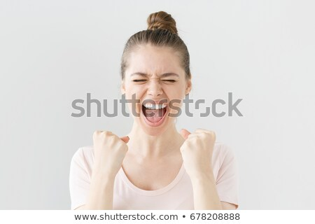 excited young business woman with hands up and fists closed stock photo © feedough
