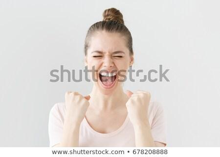 Excitado jóvenes mujer de negocios las manos en alto cerrado blanco Foto stock © feedough