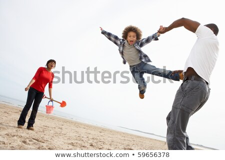Father swinging son in the air Stock photo © IS2