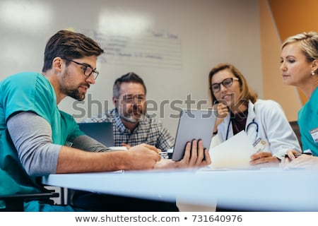 nurse and doctor having discussion on digital tablet stock photo © wavebreak_media