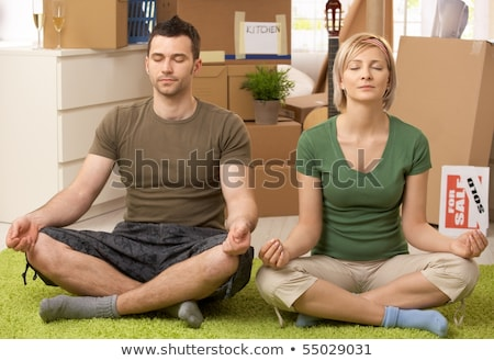 Man doing yoga with moving boxes Stock photo © IS2