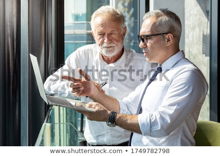 Portrait of older man and young woman Stock photo © IS2