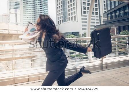üzletember nő sietség felfelé fut üzlet Stock fotó © FrameAngel