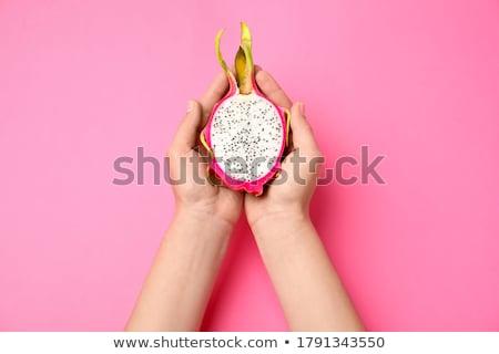 Woman holding pear. Stock photo © iofoto