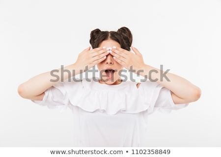 photo closeup of excited teenage woman with double buns hairstyl stock photo © deandrobot