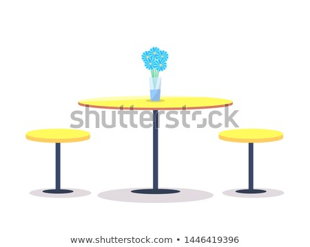 empty round table with flowers on top two chairs stock photo © robuart