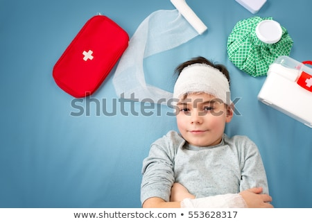 Stock photo: Doctor helping injured boy