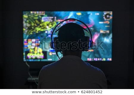 Kép derűs férfi játszik videojátékok számítógép Stock fotó © deandrobot