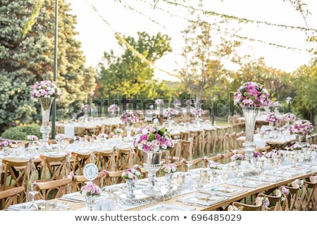 Wedding. Banquet. Chairs and honeymooners table decorated with candles, Stock photo © ruslanshramko