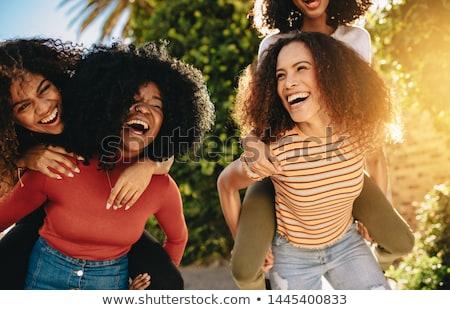 молодые · черную · женщину · смеясь · городской · улице · шарф - Сток-фото © Stasia04