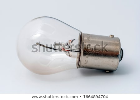 Stock photo: headlight of the main light of the white car, close-up.