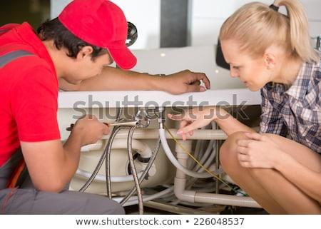 Donna sink idraulico giovani Foto d'archivio © AndreyPopov