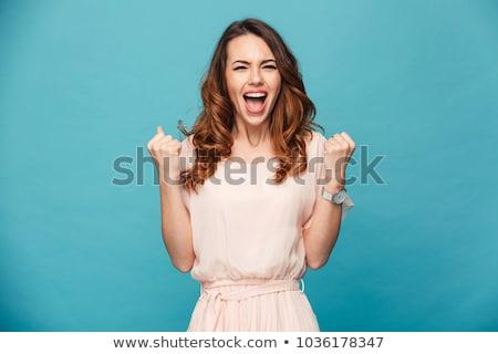 Stok fotoğraf: Mutlu · genç · heyecanlı · güzel · bir · kadın · yalıtılmış · mavi