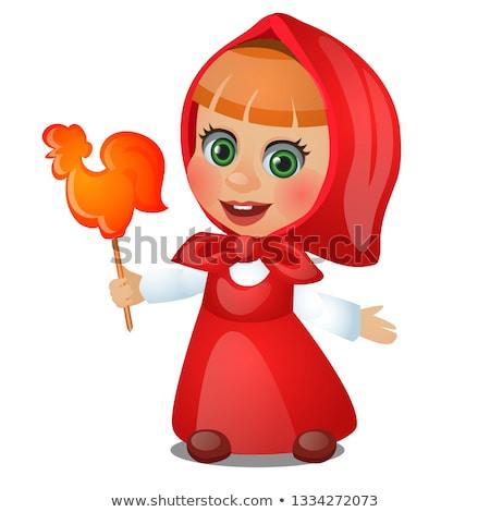 Kislány piros sál tart nyalóka űrlap Stock fotó © Lady-Luck