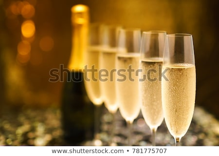 bottle and glass of sparkling wine or champagne stock photo © robuart