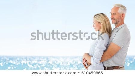 Couple hugging against blurry beach Stock photo © wavebreak_media
