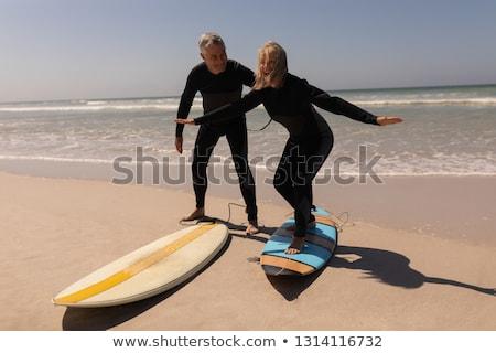 вид сбоку активный старший женщину Постоянный доска для серфинга Сток-фото © wavebreak_media
